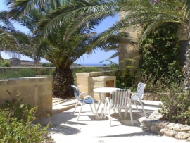 GHANNEJ holiday villa patio with seating area