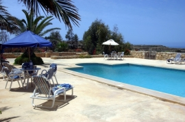 GHANNEJ holiday villa pool area with view