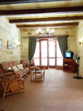 GIDI holiday house sitting room with multilingual channels on television