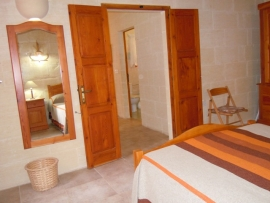 Otherside of DUN NASTAS holiday house double bedroom leading to bedrooms hallway
