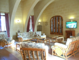 GHANNEJ holiday villa sitting room with multilingual channels on flat screen television