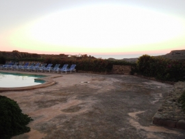 Colourful sunset in GHANNEJ holiday villa pool area