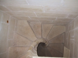DUN NASTAS holiday house stone spiral stairs from upstairs to downstairs