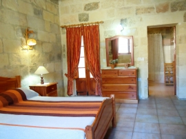 MARGIA holiday house double bedroom with patio and with en suite bathroom