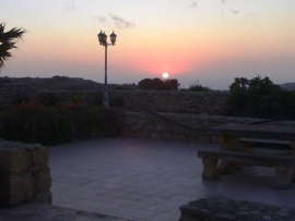 GHANNEJ holiday villa barbecue area during sunset